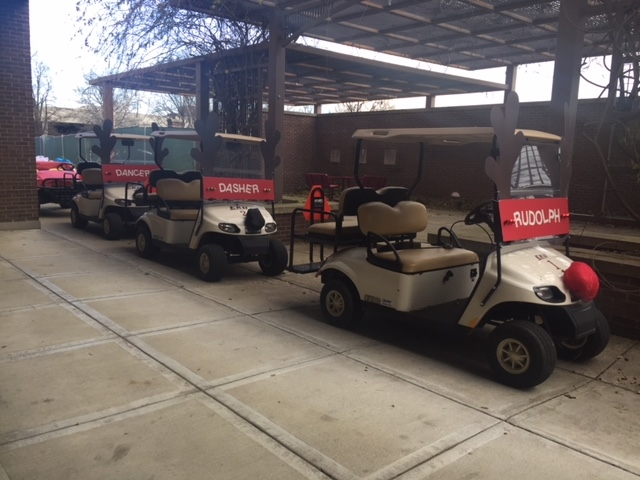 A Group of Golf Carts costumed as Reindeer