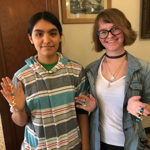 Two students showing their Identity Keychains in Burnam Hall